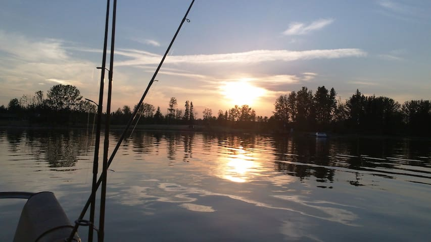 sled lake sunset