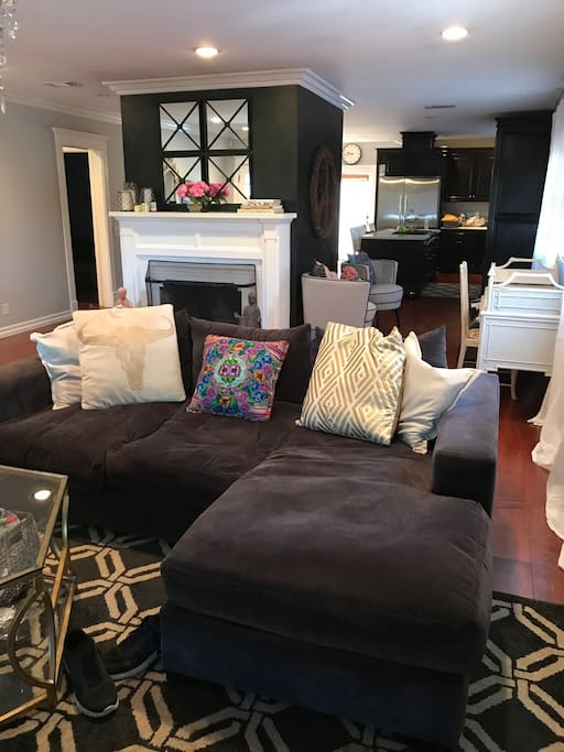 Lots of room to unwind and chill - beautiful double sided working fireplace that faces the living room and kitchen/ dining area