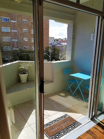 Sliding doors leading onto the balcony with table & chairs