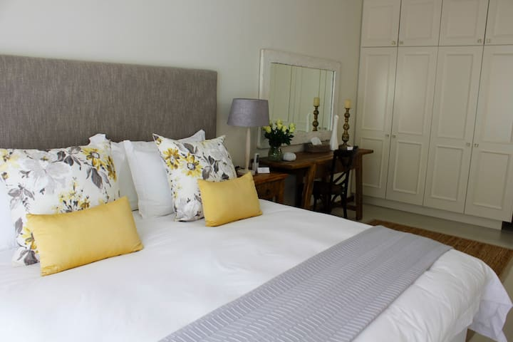 Luxuriously decorated bedroom with crisp white pure cotton linen