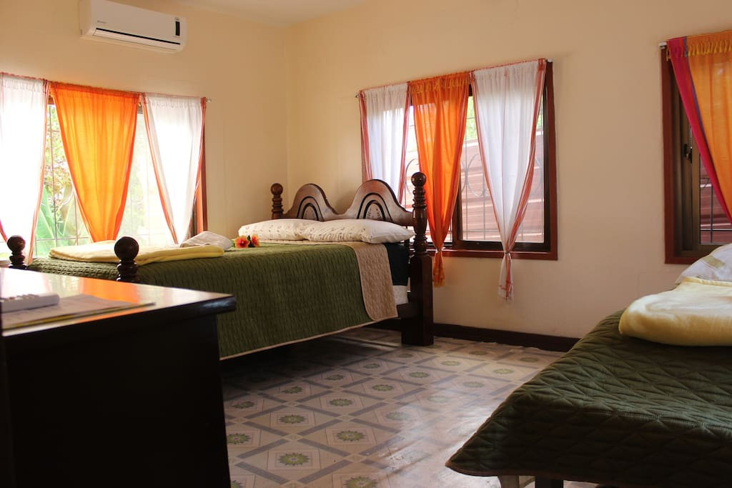 Sleep comfortably in our family size bedroom (1 queen, 2 single beds)
