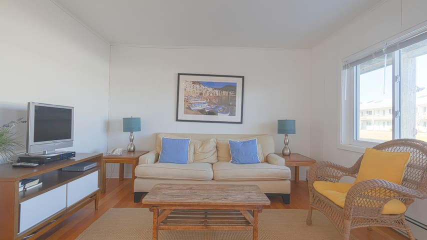 Relax and Read a Book in this Serene One Bedroom Unit Steps from Town and the Ocean