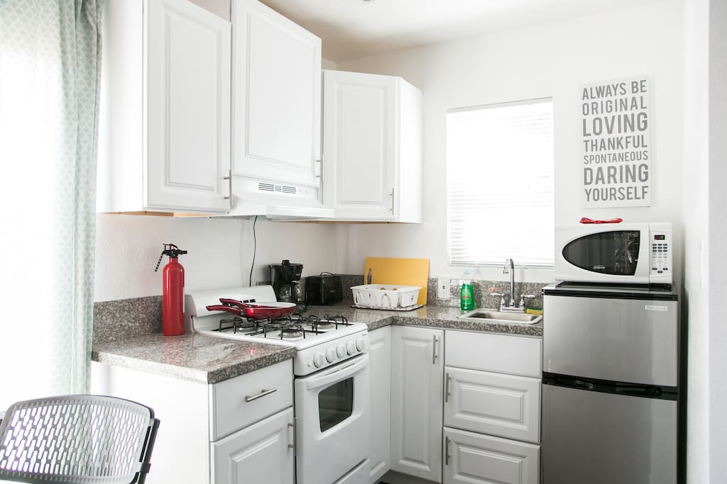 The kitchenette has a sink, stove, fridge, freezer and microwave.