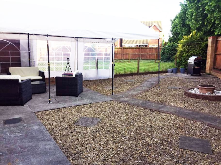 Spacious garden with furniture, fire pit, marquee and BBQ to enjoy your weekend come rain or shine!