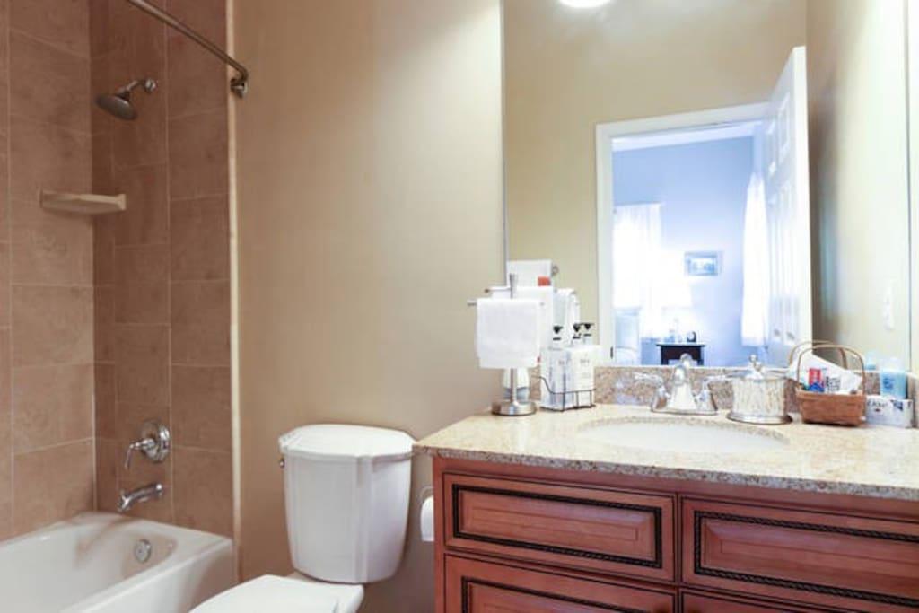 Private en-suite bath w/ shower/tub combo.