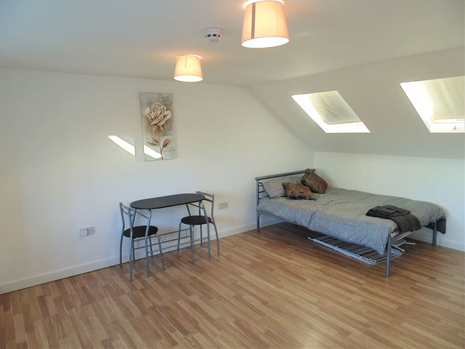 Double bed with table and chairs