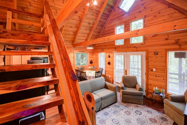 The large windows throughout the cabin allow for natural sunlight to trickle through.  Large seating area available for guests.