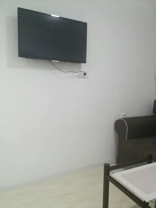 LCD TV on wall with cable TV and USB connection