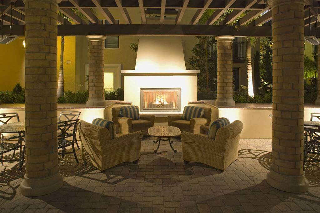Stay warm by the fire pit adjacent to the pool.