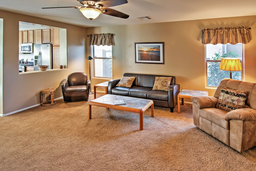 The spacious living room is the perfect place to unwind
