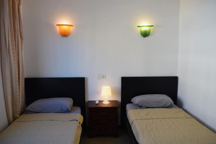 Double room (2 single beds) at apt in Cala Bona