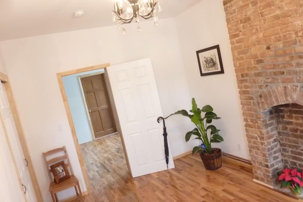 Spacious bedroom with large built-in closet and beautiful exposed brick (no-working) fireplace