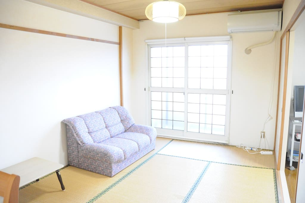 Bedroom with a comfortable couch.
