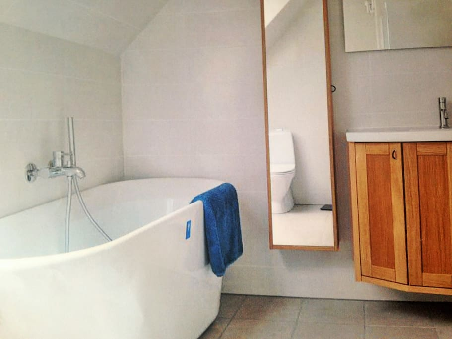 New bathroom with tub and rainwater-shower