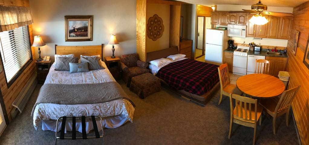 Two beds, table with 4 chairs and full kitchen including fridge, stove, microwave and cooking supplies