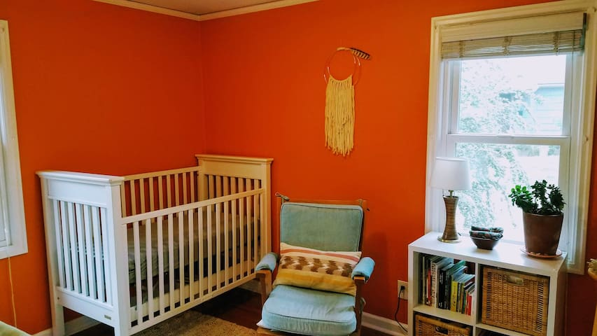 Simple and calm nursery directly across from master bedroom has everything you need to care for little ones. We even have extra baby carriers!