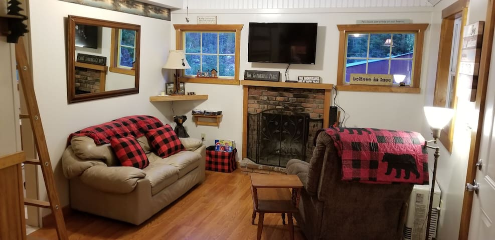 Cozy, rustic interior is comfortable for a couple or small family.