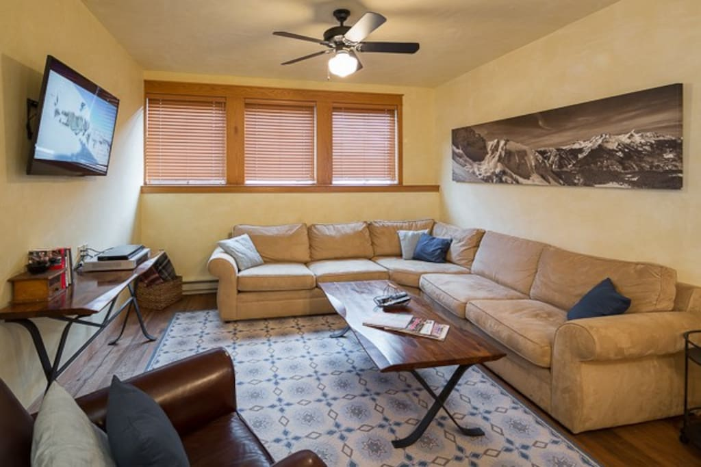 Comfortable and cozy living area with flat screen TV and all new furniture.