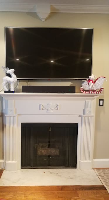 """54"""" TV, electric fireplace, blue tooth sound bar, cable TV, and Netflix."""