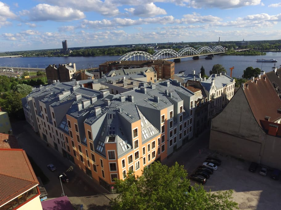 Bird view to the condominium   where the Old Riga Julia apartments are situated, as well as Daugava river Embankement and Railway bridge