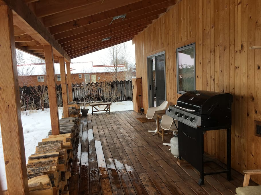 large covered porch area with BBQ.
