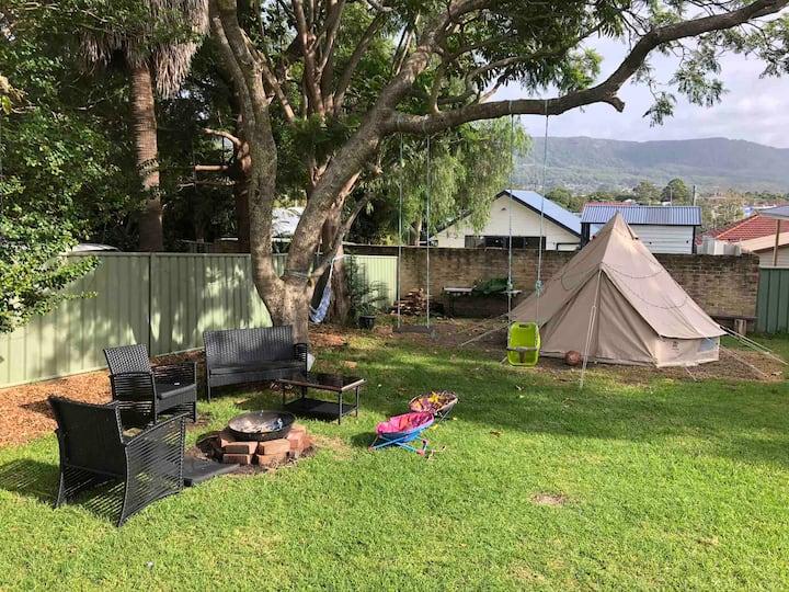 Bell tent backyard glamping