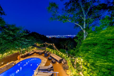 Pool with plenty of seating for everyone. Charcoal grill, misters & jacuzzi!