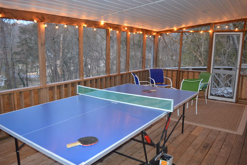 Screened in porch with ping pong and seating.