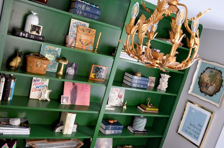 Original built-in bookshelves...painted kelly green with lots of fun books, etc. This shelf located in bedroom #3 (twin bed room).