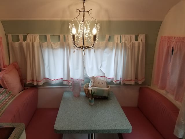 Table turns into a bed but only for 5 feet 5 inch person or less. The light switch for the chandelier is located on the ceiling close to the cabinets above the stove.