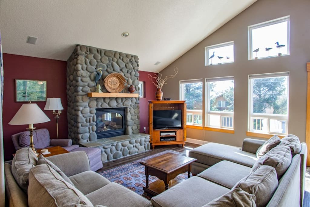 Living room with wood flooring and gas fireplace