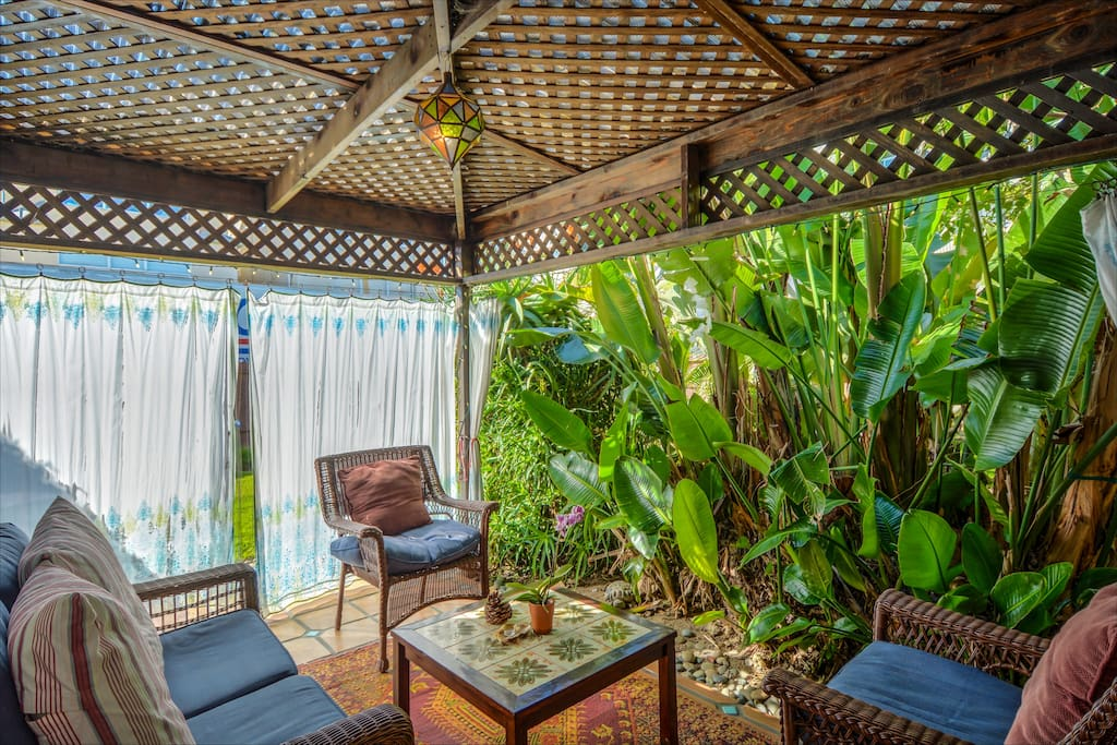 Tropical Cabana Room with surrounding curtains for added privacy.