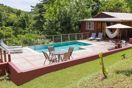 Mary's Hill Lodge, Tobago Wooden house with pool.