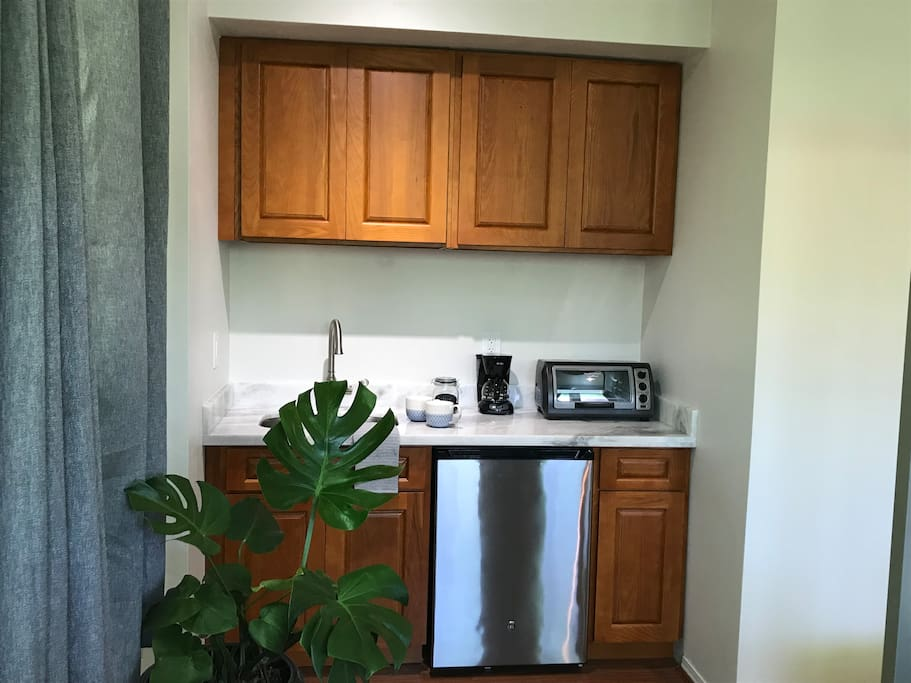 Kitchenette includes dish ware, glasses, coffee maker, coffee, toaster oven