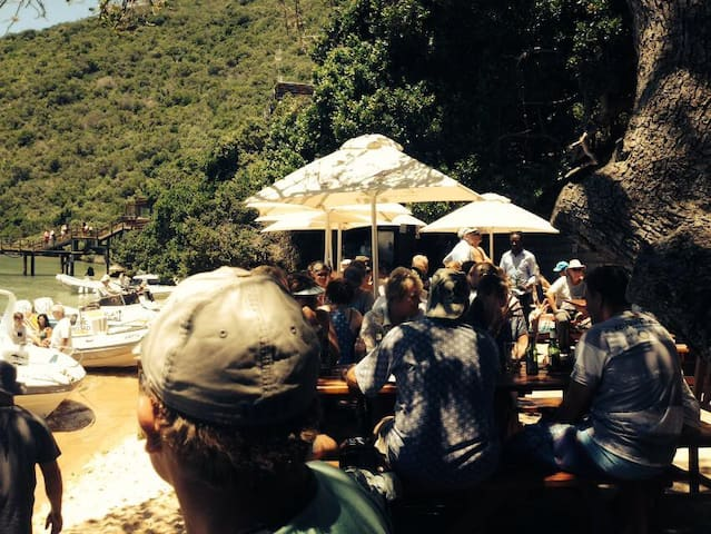 The Beach Bar which you can only get to by boat.  Don't worry we'll take you there :-) Open December to April.
