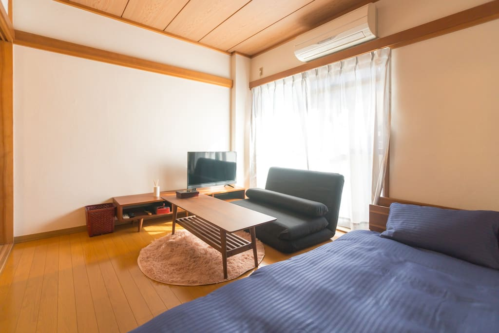 Japanese style living and bedroom with lots of sunshine.