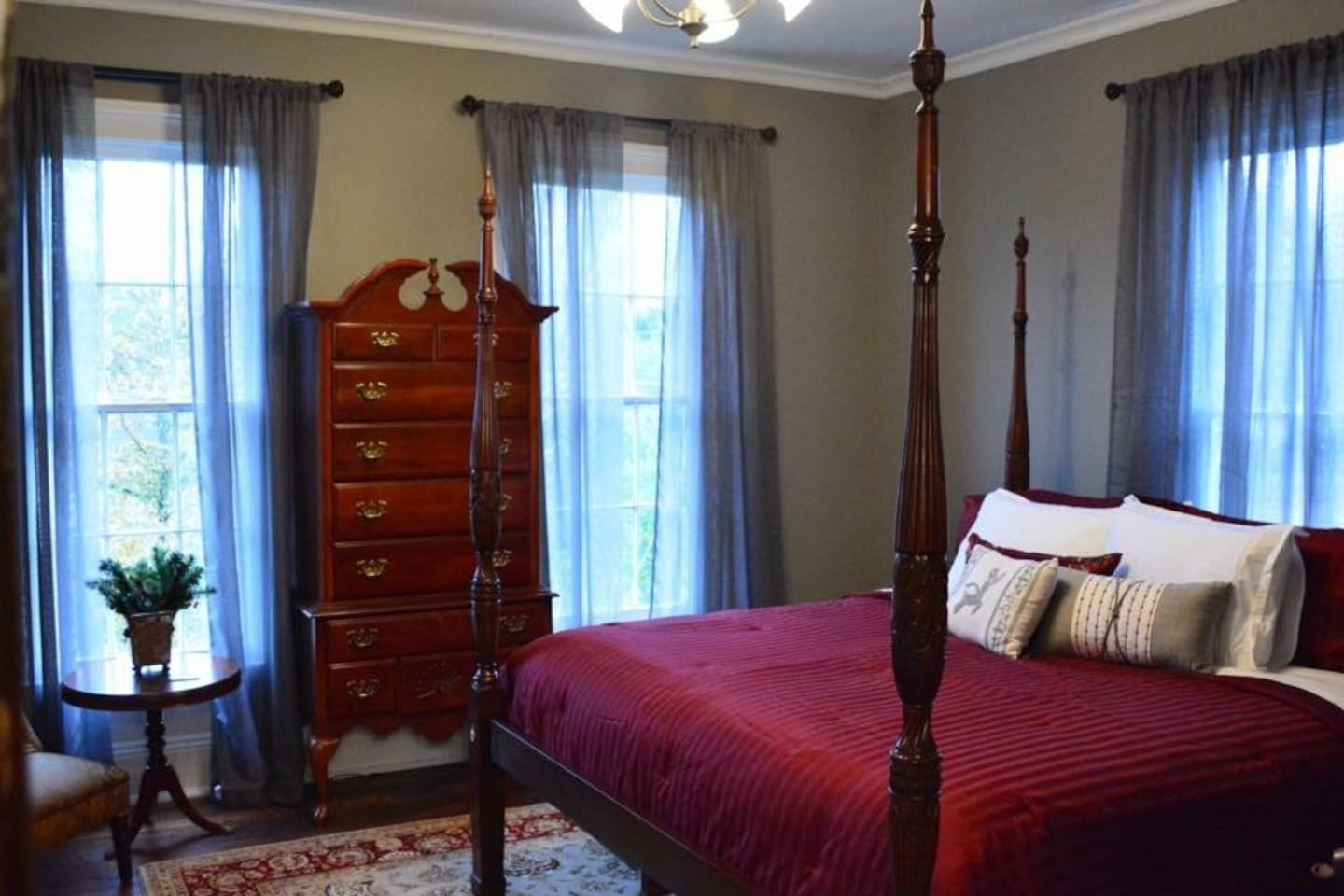 """The """"Ruby Room"""" has a king-size 4- poster rice bed, WiFi, cable, flatscreen tv, and access to bath with claw foot tub/shower. This room is on the second floor."""