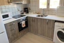 Cocina nueva, equipada,completa ,  lavadora-secadora.