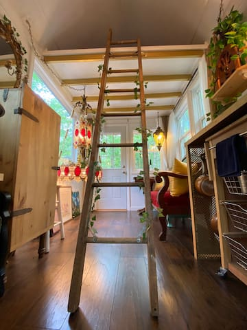 Old extended ladder now has a new life! A ladder to your loft bed. Please secure ladder's hook properly into the gold handles while in use. Ladder can be moved to the kitchen side when not in use.