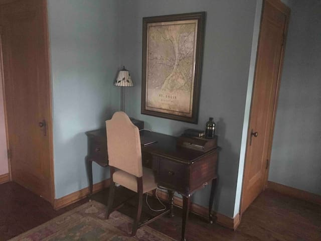 The desk area in the living room is ideal for business travelers.