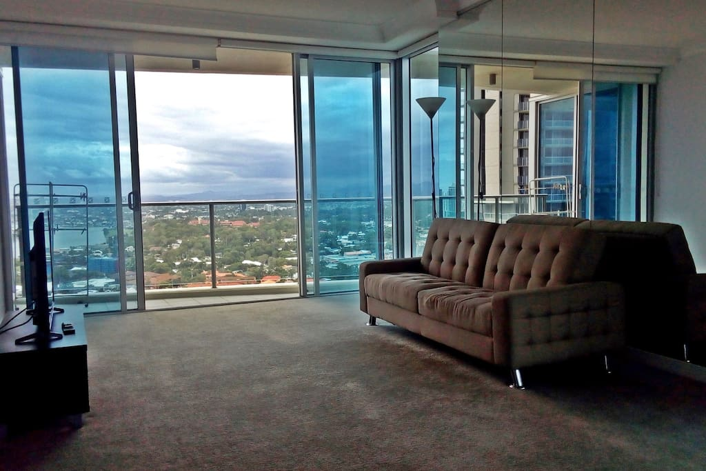 Spacious Living Room and Balcony with Southern Views