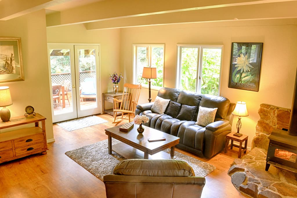 Living room with covered deck through French doors
