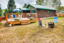 Spacious deck with Weber gas grill, patio table with 4 chairs, plus bonus backyard fire-pit and 4 extra camp chairs.