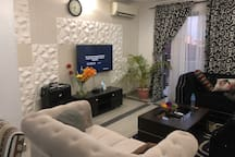 CONFY LIVING ROOM WITH A CUVE SMART TV THAT YOU CAN LOG IN TO NETFLICKS OR YOU TUBE. AND WITH A REAL EARTHY FEEL AND A VIEW OF THE SWIMMING POOL
