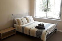 Large main bedroom with ample wardrobe space. Can be set up as king bed or twin singles.