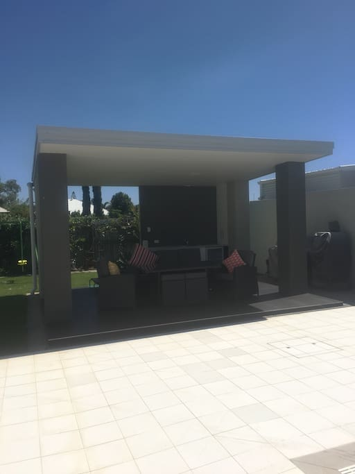BBQ area, with fridge, sink, 4 burner BBQ and pizza oven
