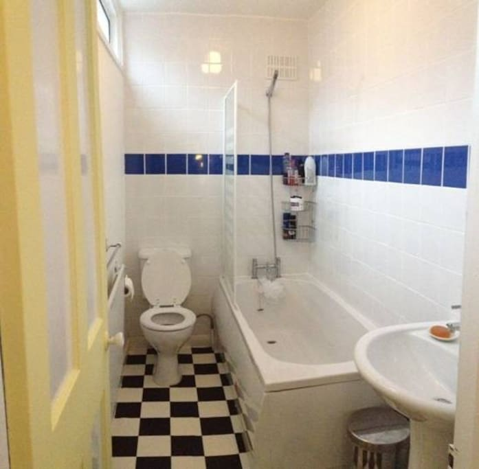 Shared bathroom with both shower and bath.