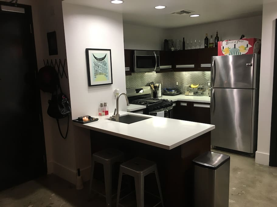 Full kitchen with dishwasher and breakfast bar.
