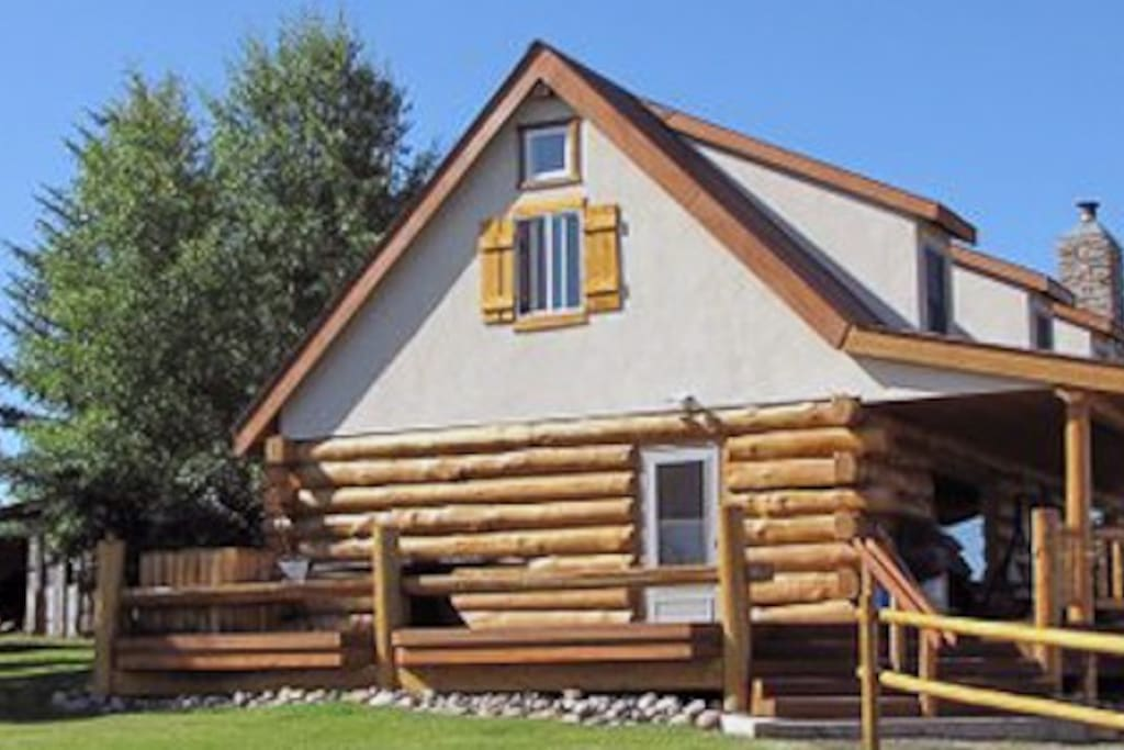 East side of the Lodge with large deck and log benches