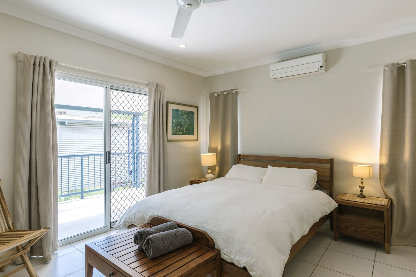 The large and bright master bedroom has an ensuite bathroom, built-in robes and a private balcony. Beach towels are also provided.